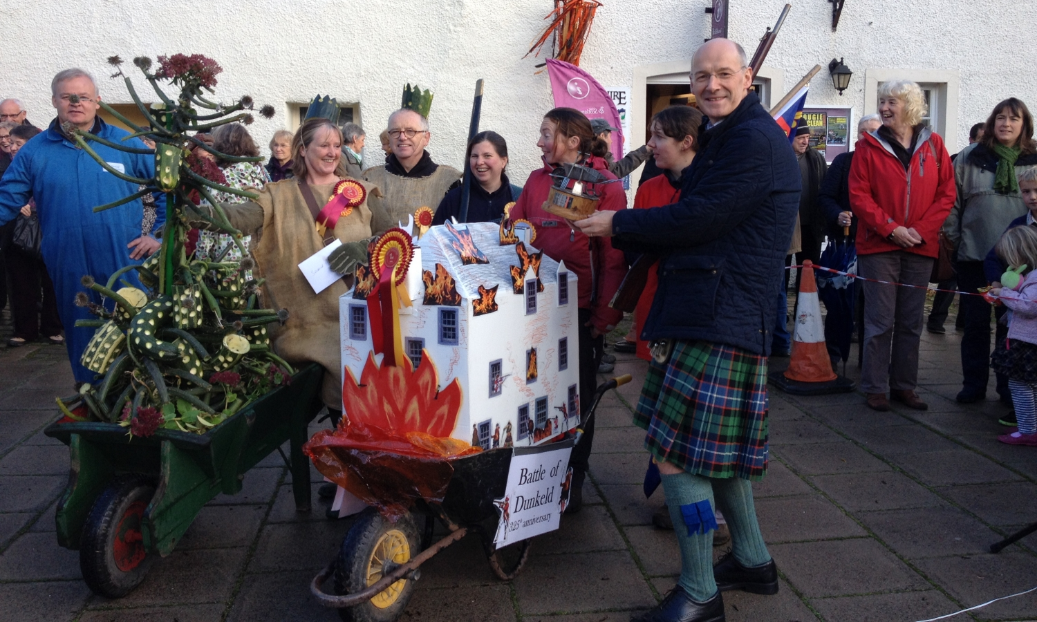 John Swinney with Decorated Wheelbarrows